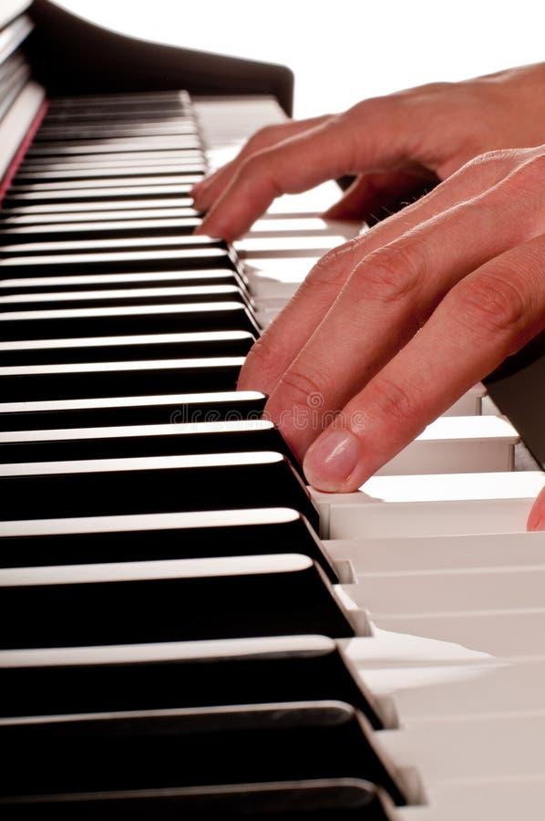 Jeu du piano photographie stock