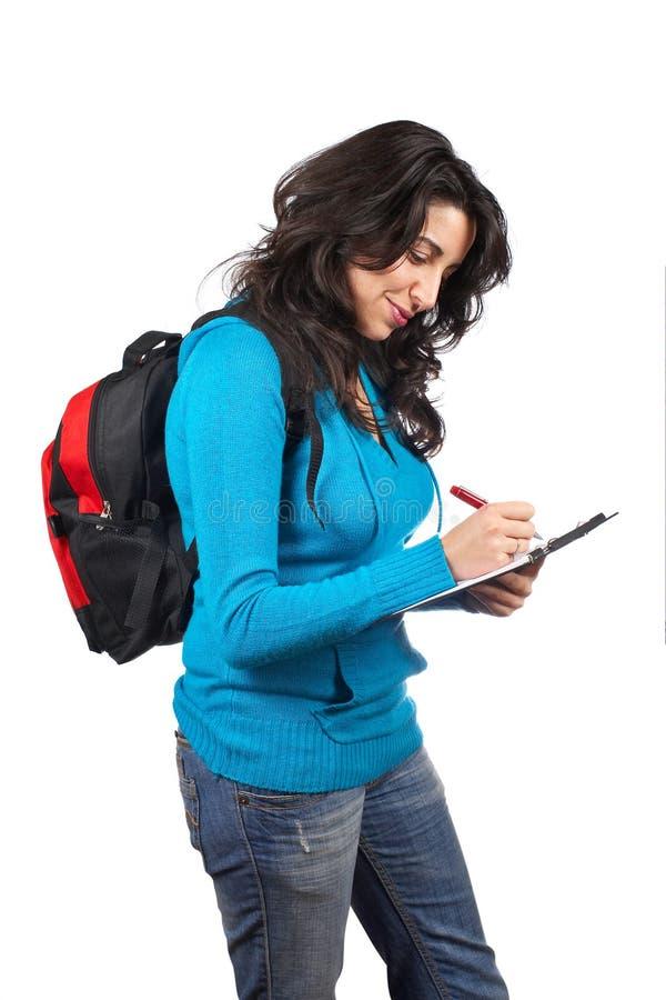 Jeune écriture de femme d'étudiant image libre de droits