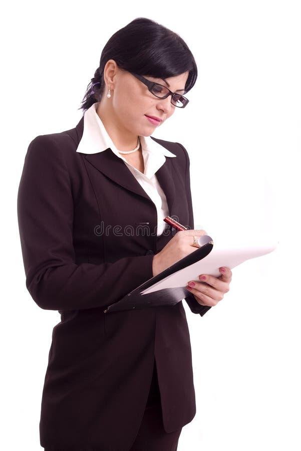 Jeune écriture de femme d'affaires photo stock