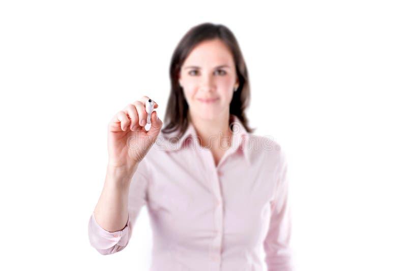 Jeune écriture de femme d'affaires quelque chose, sur l'écran d'isolement sur le fond blanc. photographie stock