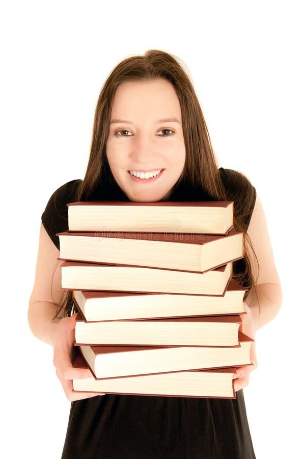 Jeune étudiant avec une pile des livres photos libres de droits