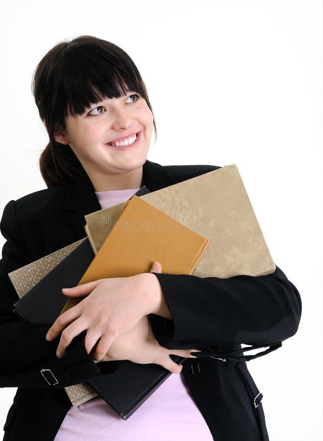 Jeune étudiant féminin attirant avec des livres image stock