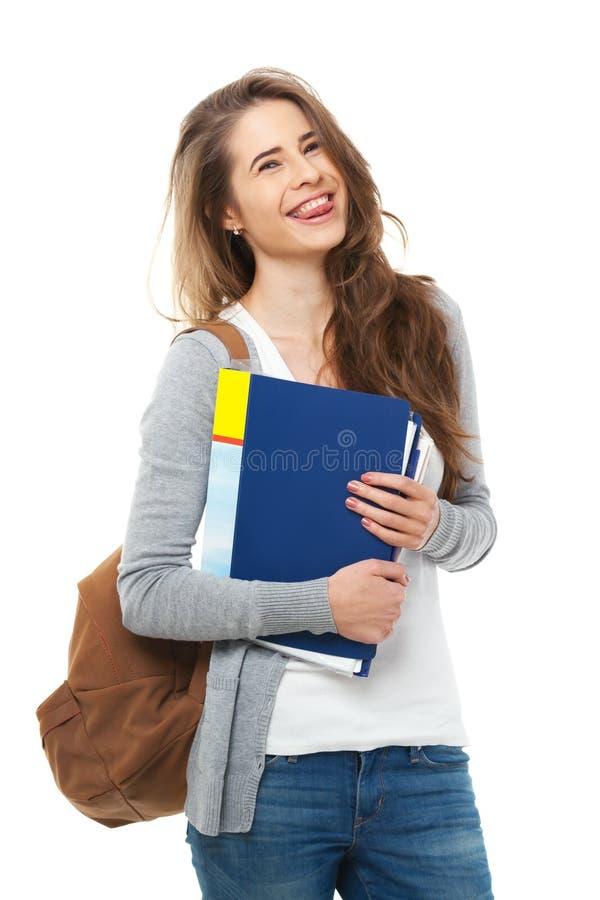 Jeune étudiant heureux d'isolement sur le blanc photographie stock libre de droits
