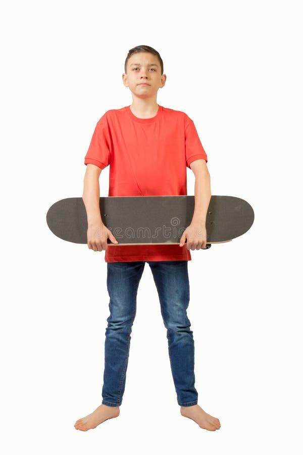 Jeune adolescent d'isolement sur le blanc photo stock