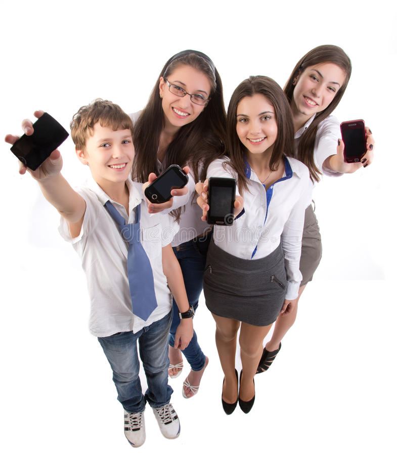 Jeune adulte avec des téléphones portables photos libres de droits