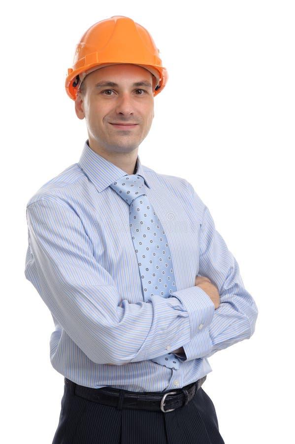 Jeune agent de maîtrise heureux avec le casque antichoc images stock