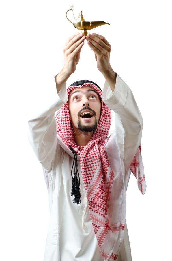 Jeune Arabe avec la lampe images stock