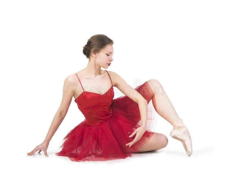 Jeune ballerine dans un tutu rouge photo stock