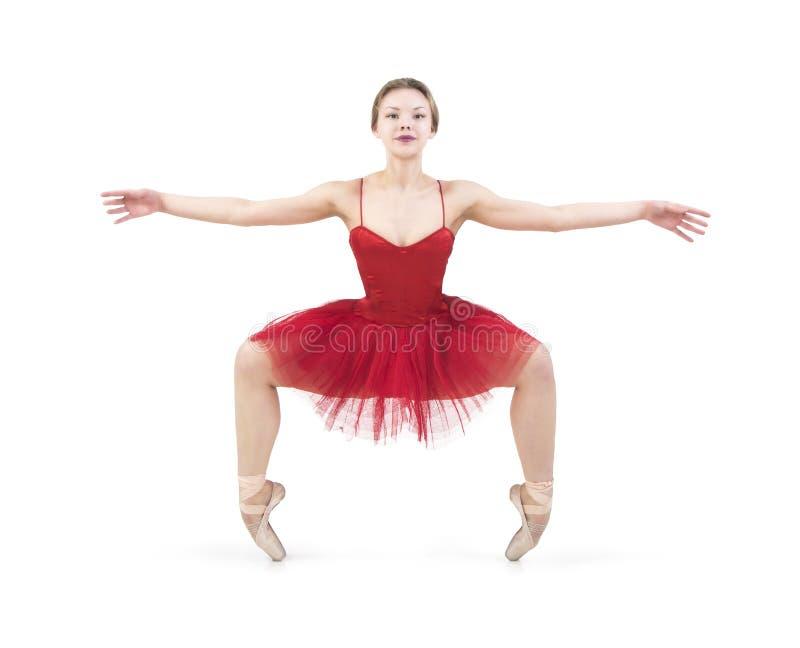 Jeune ballerine dans un tutu rouge photos stock
