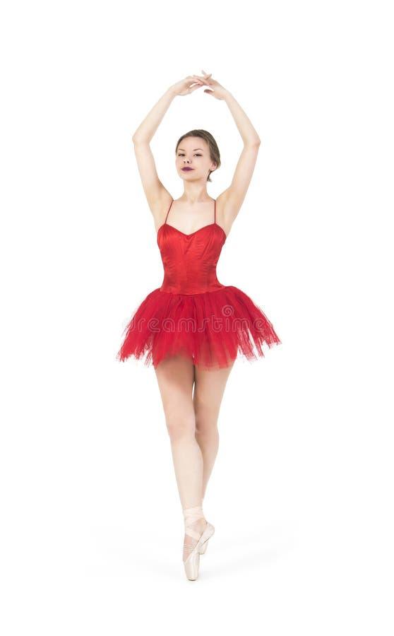 Jeune ballerine dans un tutu rouge images stock