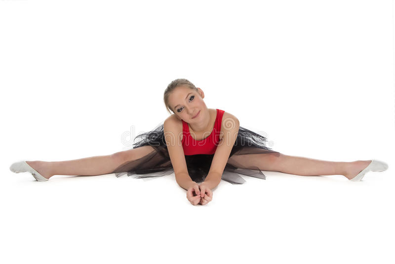 Jeune ballerine s'asseyant sur le plancher images libres de droits