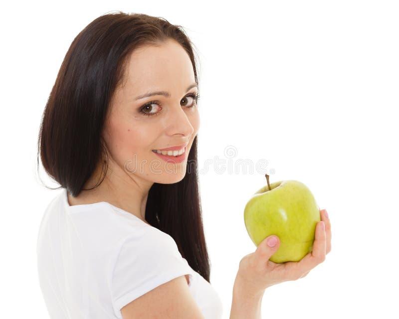 Jeune beau femme avec une pomme image stock