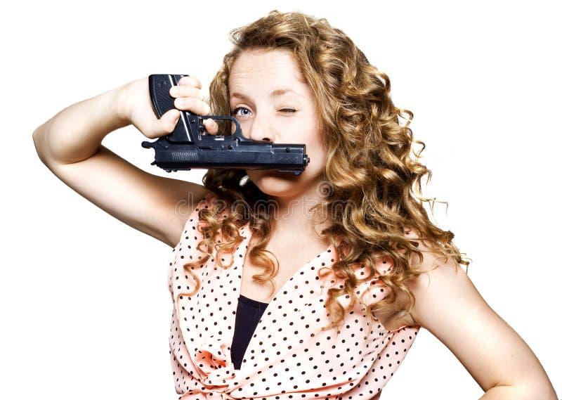 Jeune beau femme retenant un canon photo stock
