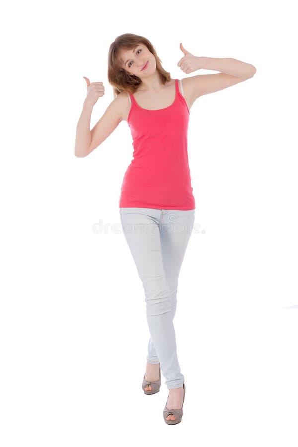 Jeune bel adolescent montrant le pouce au-dessus du blanc photographie stock