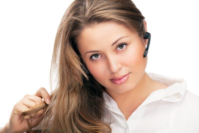 Jeune belle femme d'affaires avec headsetling photographie stock libre de droits