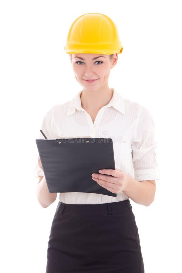 Jeune belle femme d'affaires dans le casque de constructeur avec le presse-papiers image libre de droits