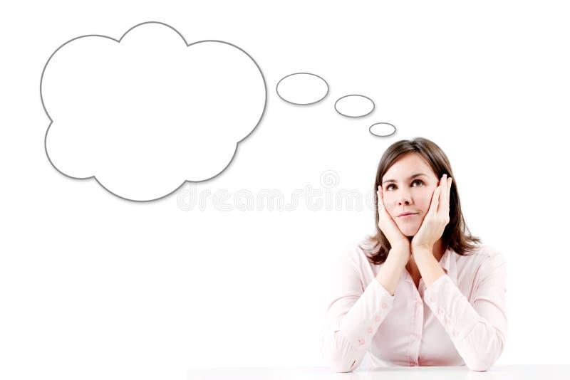 Jeune belle femme d'affaires pensant avec la bulle. photos libres de droits