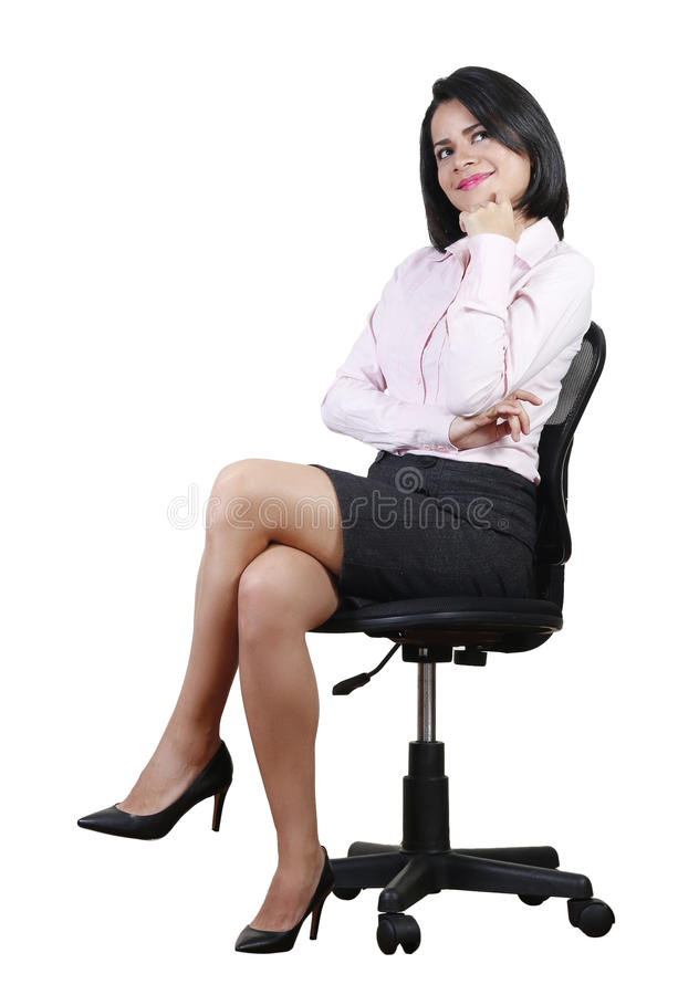 Jeune belle femme d'affaires rêvassant photographie stock