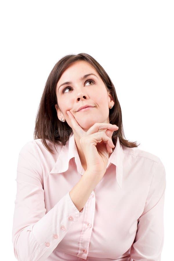 Jeune belle pensée de femme d'affaires. images stock