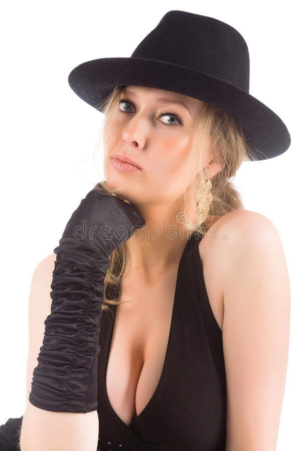 Jeune blonde avec le chapeau noir image libre de droits