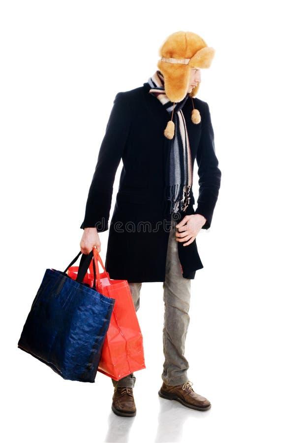 Jeune camarade avec de grands sacs photos stock