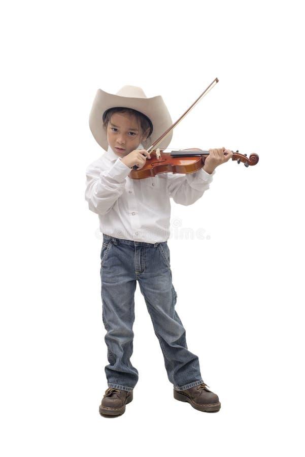 Jeune chapeau de cowboy d'usage de garçon jouant le violon images stock