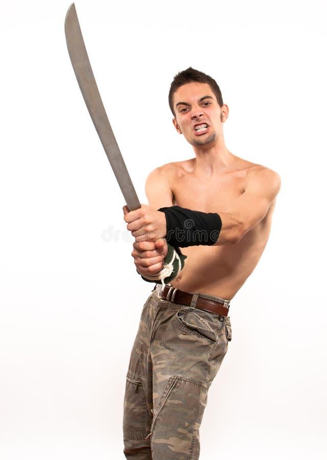 Jeune chasseur retenant une machette photos libres de droits