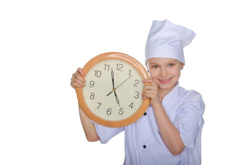 Jeune chef avec l'horloge image libre de droits