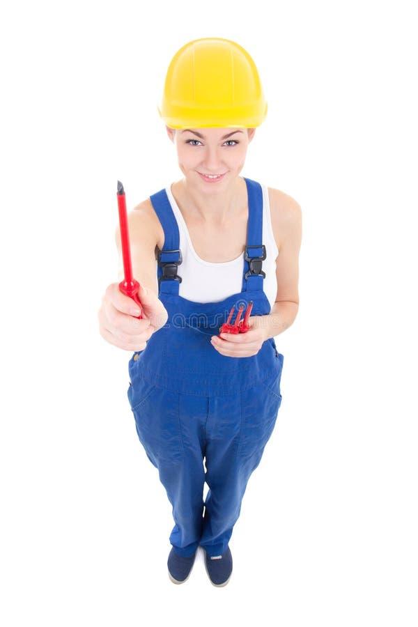 Jeune constructeur attrayant drôle de femme dans les vêtements de travail avec screwdrive image libre de droits