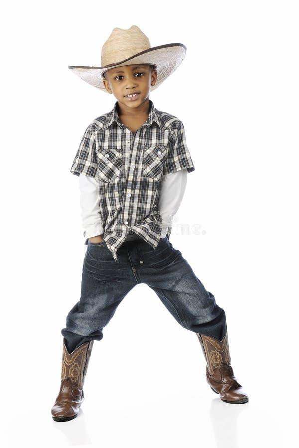 Jeune cowboy à jambes arquées images libres de droits