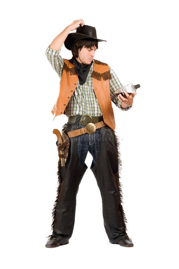 Jeune cowboy songeur avec une bouteille image stock
