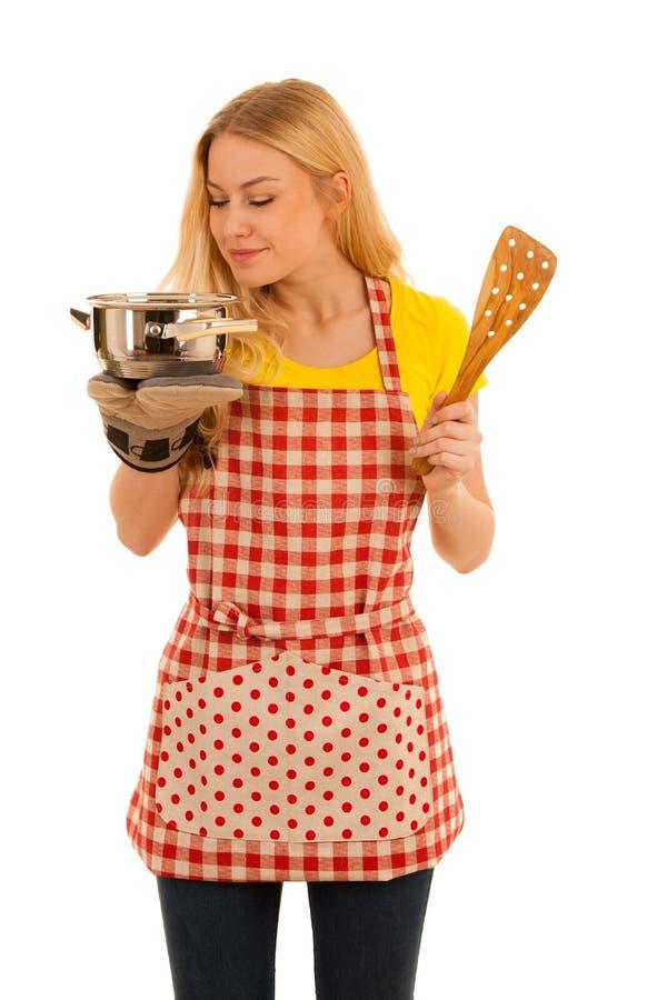 Jeune cuisson blonde de femme d'isolement au-dessus du fond blanc photographie stock