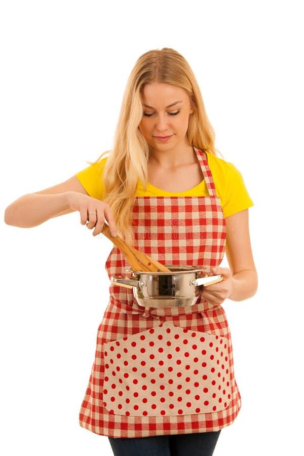 Jeune cuisson blonde de femme d'isolement au-dessus du fond blanc images libres de droits