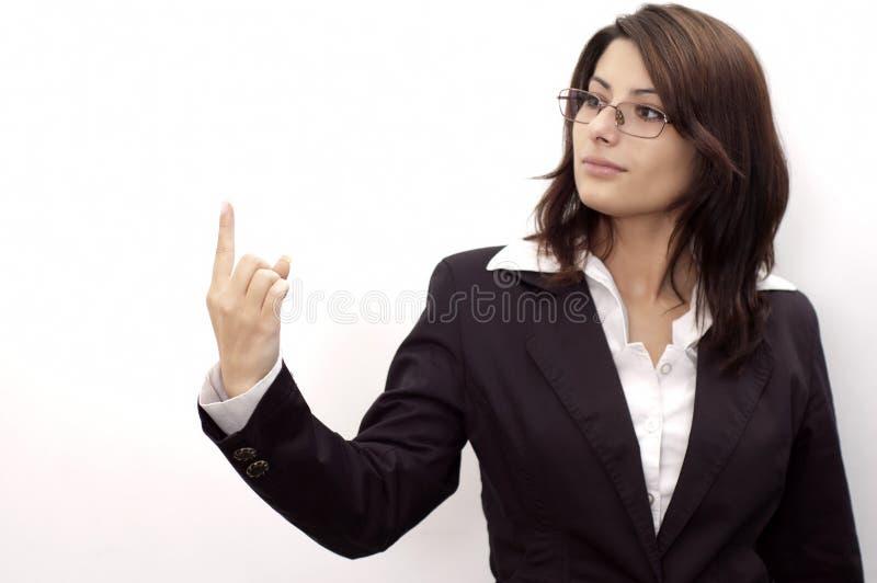 Jeune dame avec un doigt vers le haut images stock