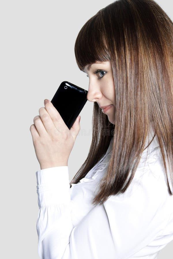 Jeune dame d'affaires avec le téléphone photo libre de droits