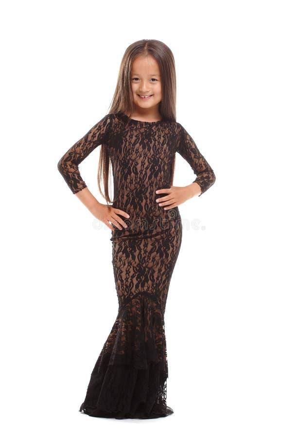 Jeune dame mignonne dans la robe élégante d'isolement sur le blanc photographie stock libre de droits