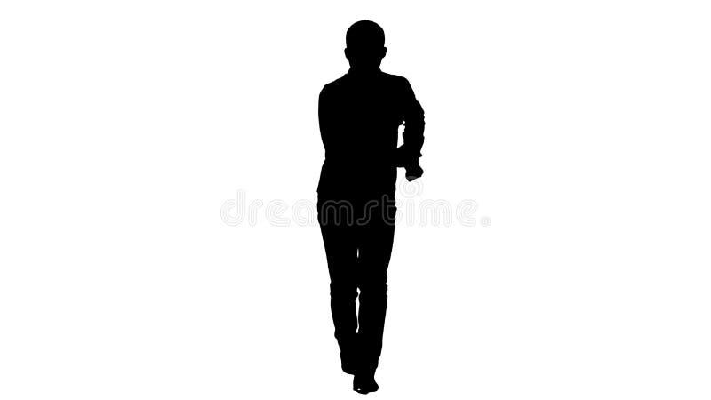 Jeune danse folle d'homme de silhouette et se branler en avant images stock