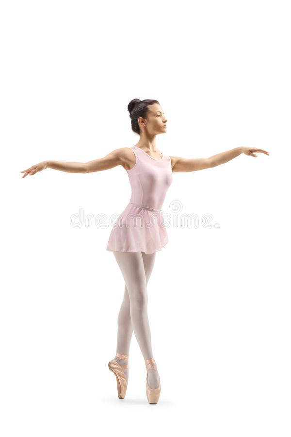 Jeune danseur classique féminin dansant sur la pointe des pieds photo libre de droits