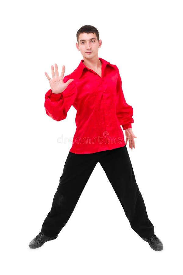 Danseur de sourire amical montrant quelques mouvements images stock