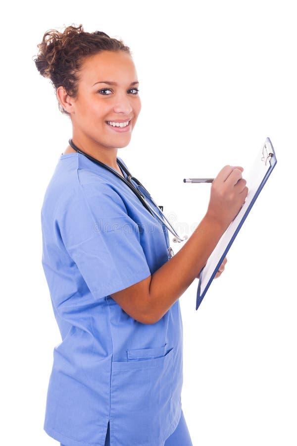 Jeune docteur avec le stéthoscope d'isolement sur le fond blanc photos stock