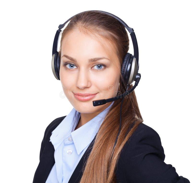 Jeune employé féminin de centre d'appel avec un écouteur photos libres de droits