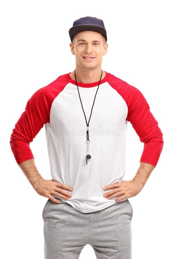 Jeune entraîneur de sports masculin photo stock