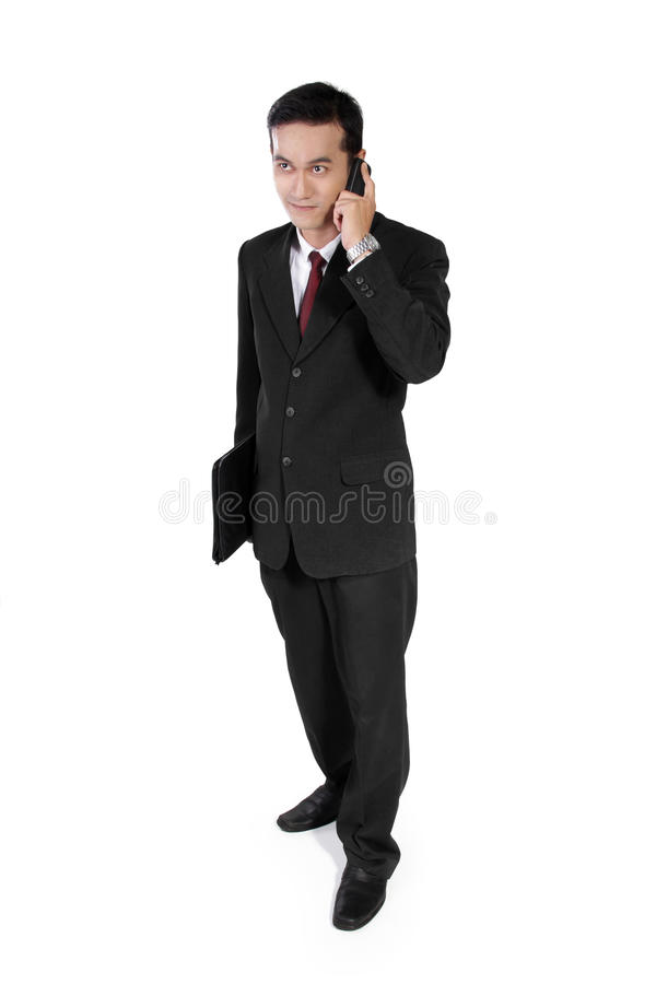 Jeune entrepreneur au téléphone photo stock