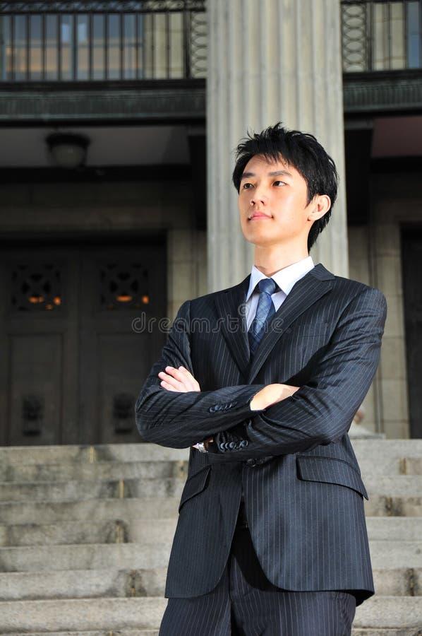 Jeune ex?cutif asiatique attendant 5 photographie stock