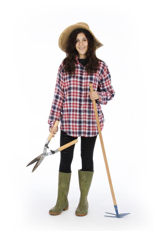 Jeune exploitant agricole avec des outils de travail images stock