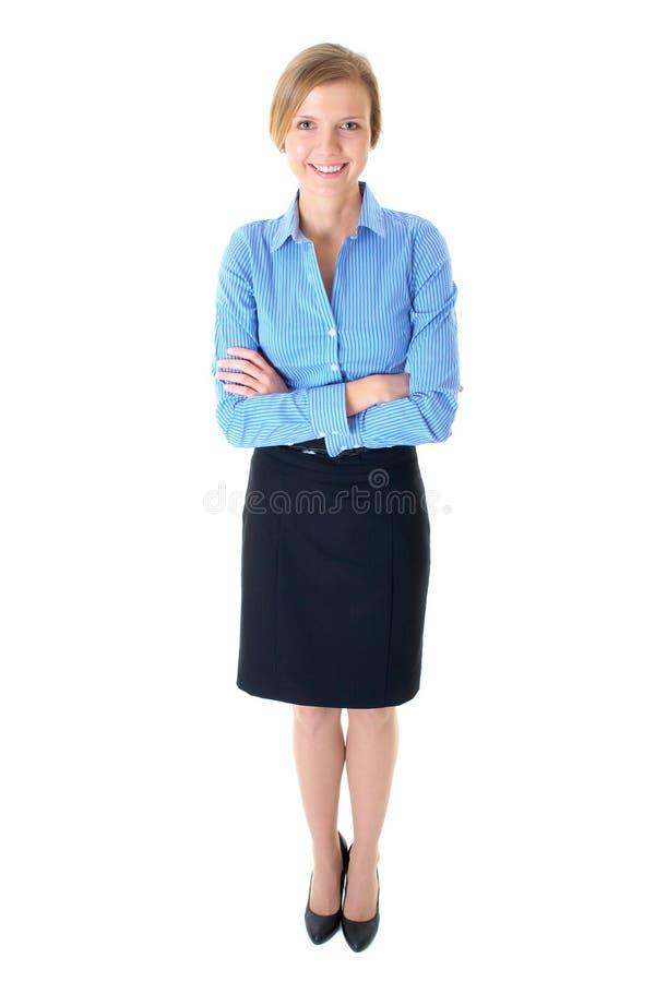 Jeune femelle blonde heureuse dans la chemise bleue, d'isolement photo stock