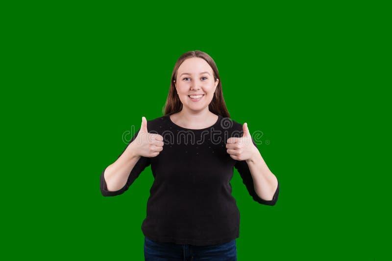 Jeune femelle renonçant à deux pouces images stock