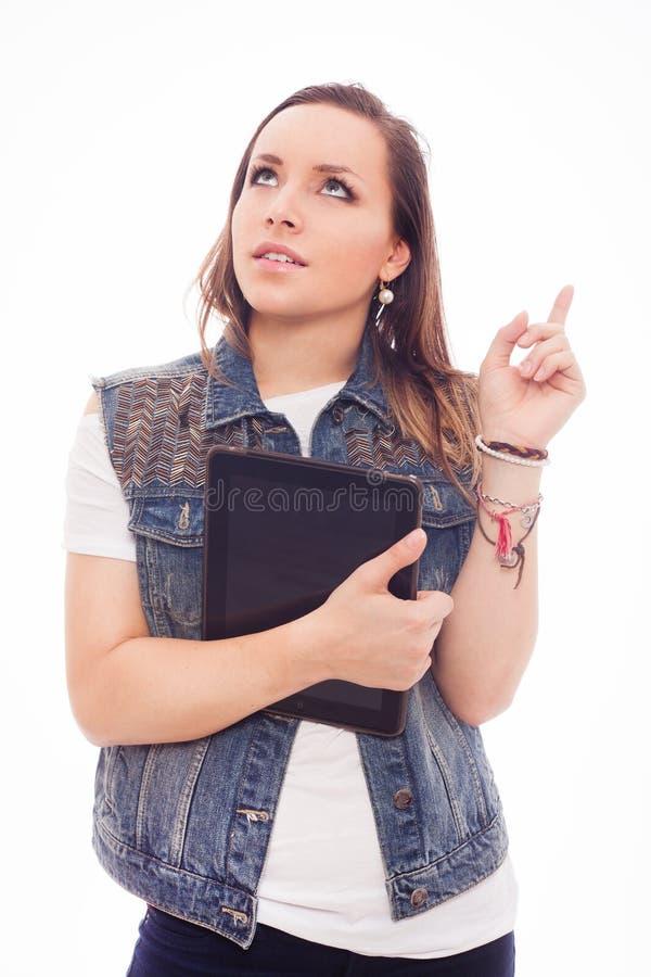 Jeune femme à la mode avec le nouveau comprimé d'isolement sur le fond blanc. photographie stock libre de droits