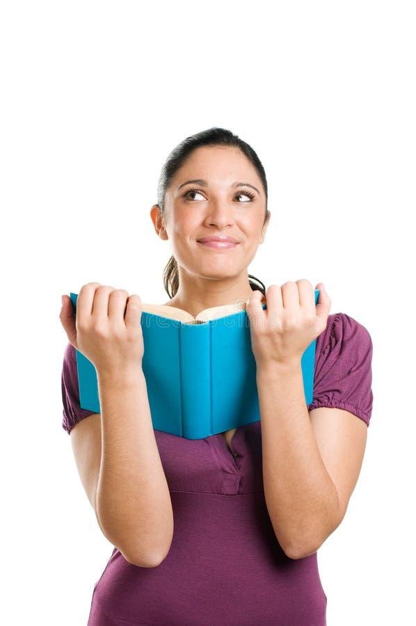 Jeune femme affichant un livre image libre de droits