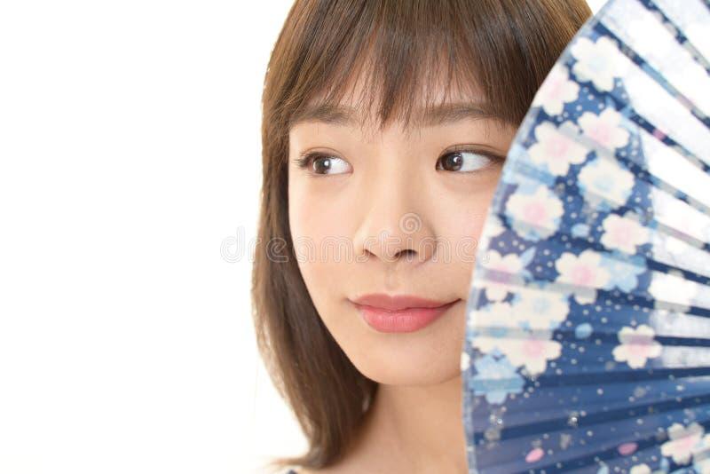 Jeune femme asiatique attirante photographie stock libre de droits
